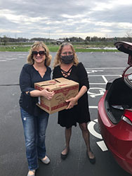 (from left) Dr. Cheryl Brady and Lorene Martin delivering pepperoni rolls to health care facilities.