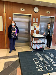 (from left) Salem nursing faculty member Diane Hill with Jamie Demain, director of the volunteer office of the Mahoning Valley Akron Children's Hospital in Boardman, delivering pepperoni rolls to hospital employees.