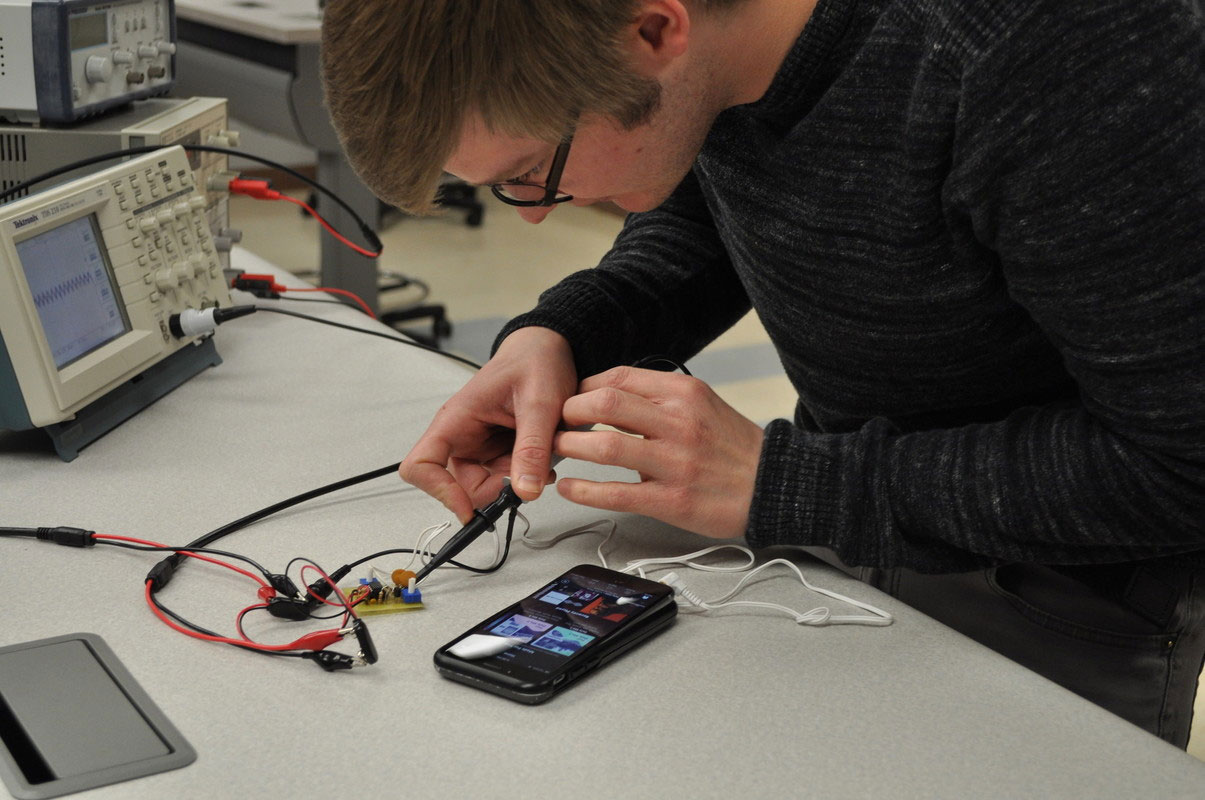 Electrical/electronic student working in lab