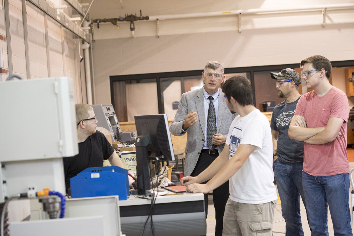 Director working with Engineering Technology students in the Advanced Technology Center