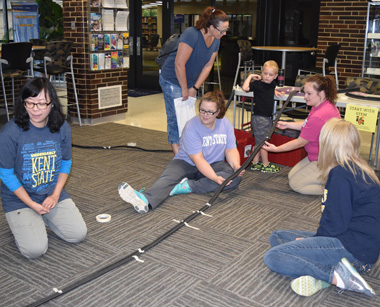 Faculty and students from the early childhood education program helped youngsters build roller coasters