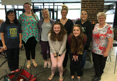 The Early Childhood Education program helped kids make roller coasters for marbles. Pictured are (from left) Dr. Tsung-hui Tu, program director; students Connie Cross, Jordin Floyd, Amanda Reiter, Emily Forsythe, Elizabeth Callahan, Connor Stewart; and Dr