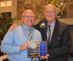 Dr. David Dees, dean, with Frank C. Dawson, accepting the Friend of the Campus Award for James and Keith Locke.