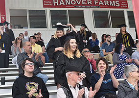 Families and graduates in the grandstands