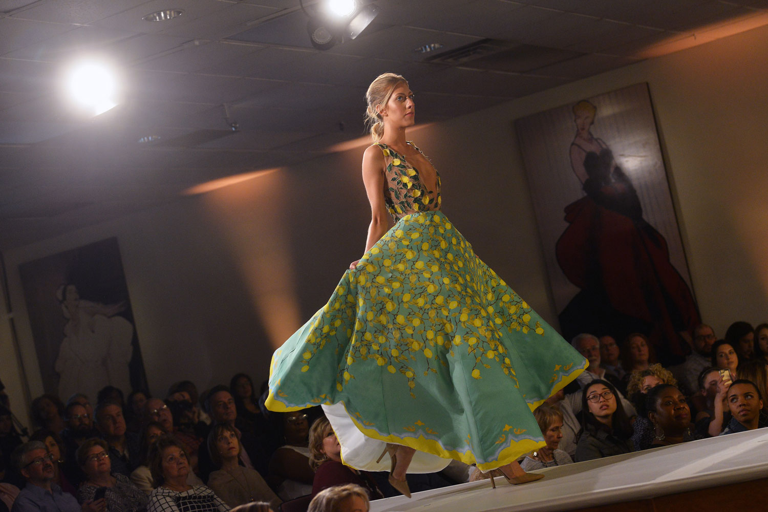 Kent State student models original designs created by fashion school students during the school's 2018 Spring Fashion School.
