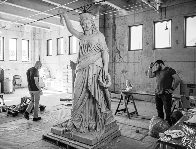 Joshua Talbott and Antonio D'Angona, inspect the 3D-printed replica of the Liberty of Poetry statue that Kent State created for the Sisters in Liberty