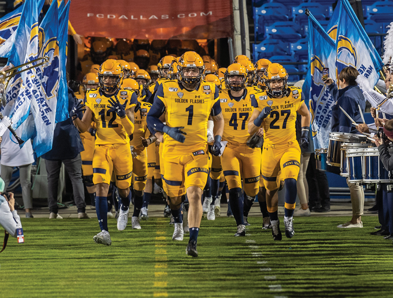 The Kent State football team running onto the field at the Frisco Bowl.