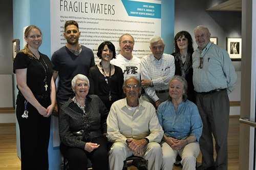 A group of people at the opening of Fragile Waters at the Massillon Museum