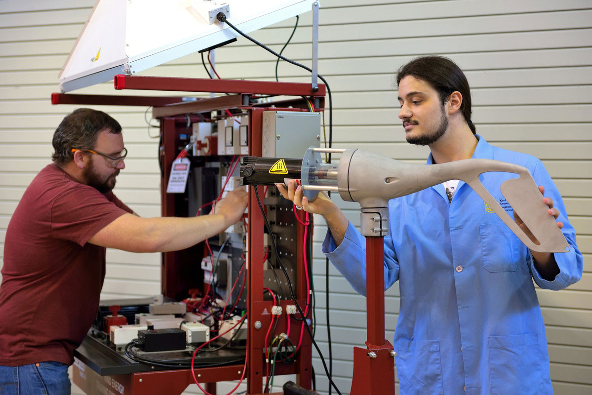 Engineering Technology students working with Alternative Energy Trainer