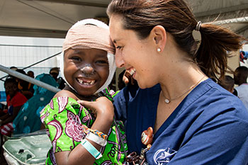 Shannon Gardiner cares for a patient on the wards of the Africa Mercy in Guinea.