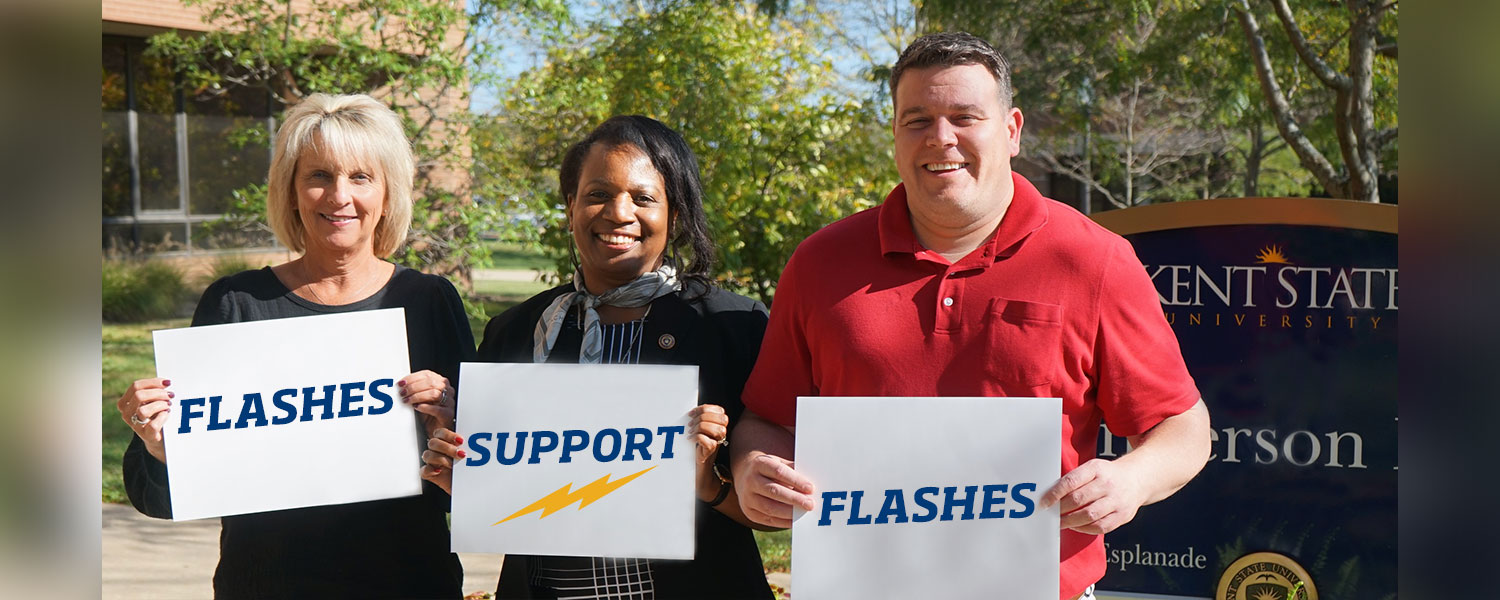 """College of Nursing leadership holding signs that read, """"Flashes Support Flashes"""""""