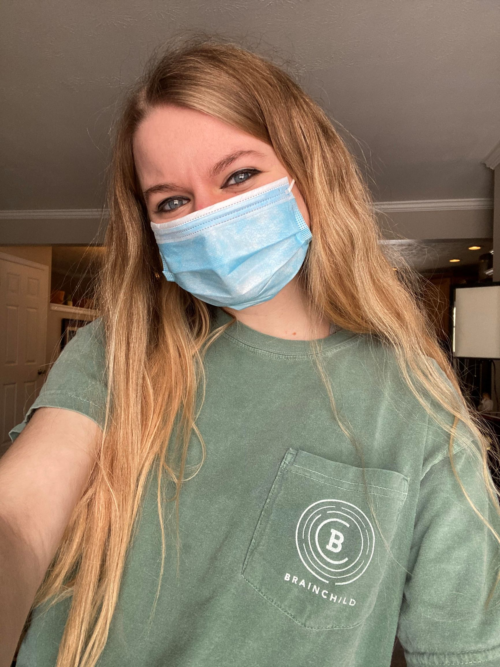 Megan Hamilton, Editor-in-Chief of Brainchild, wearing a mask at her home in Stow
