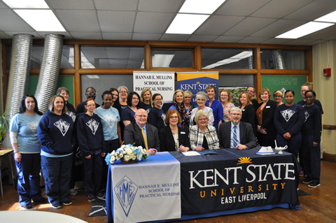 Hannah Mullin students and staff gathered with Kent State representatives for the ceremonial signing forming a partnership between the two nursing programs.