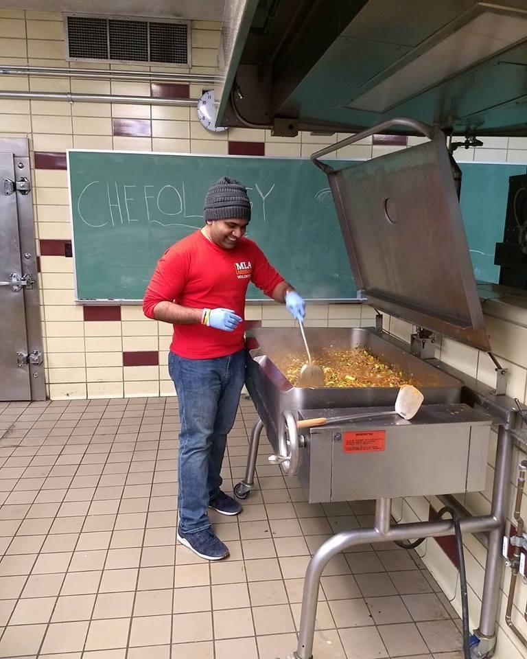 Hassan volunteering