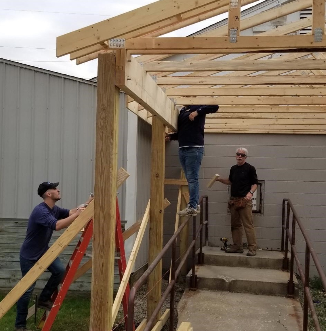 students constructing the shelter
