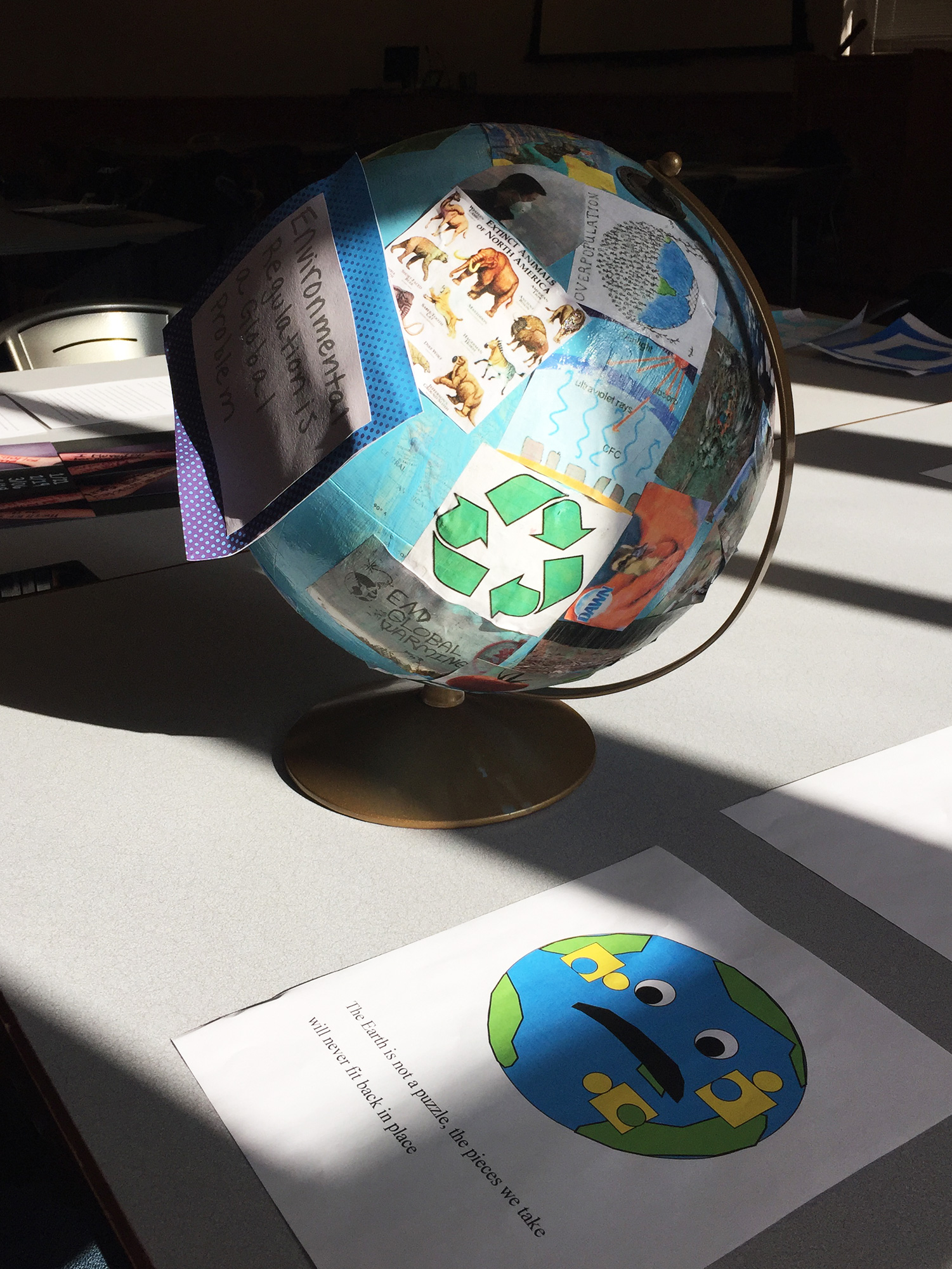 Globe covered with environmental messages