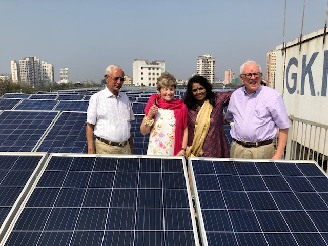 Picture of David and Janet Dix, Shri Shah and the College's solar power