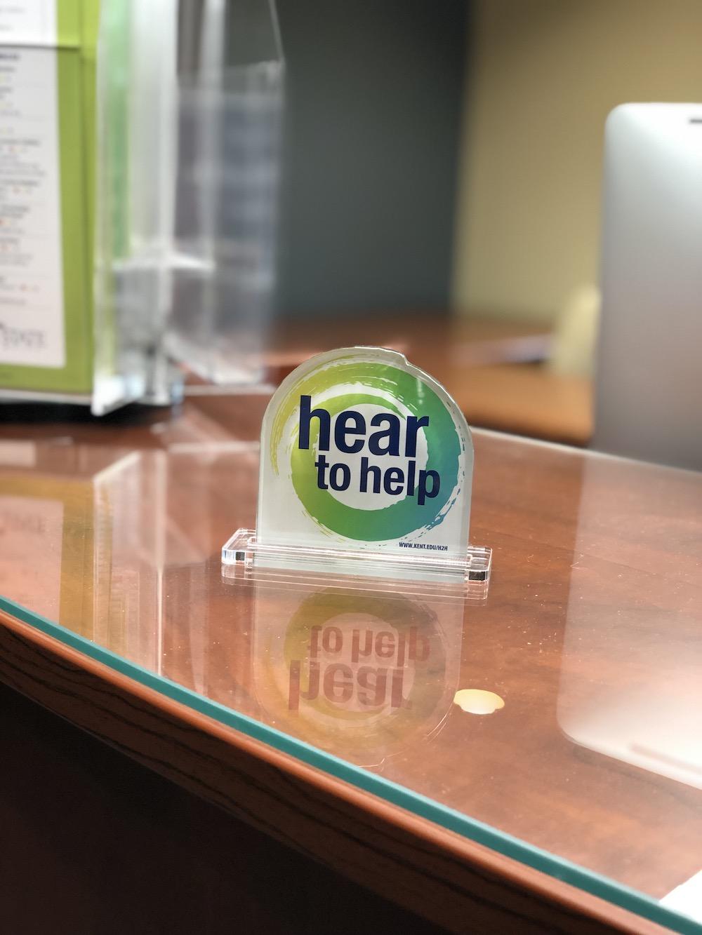 Hear to Help desk plaque