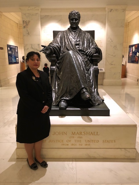 Kimberly Cleveland standing in front of a statue of John Marshall