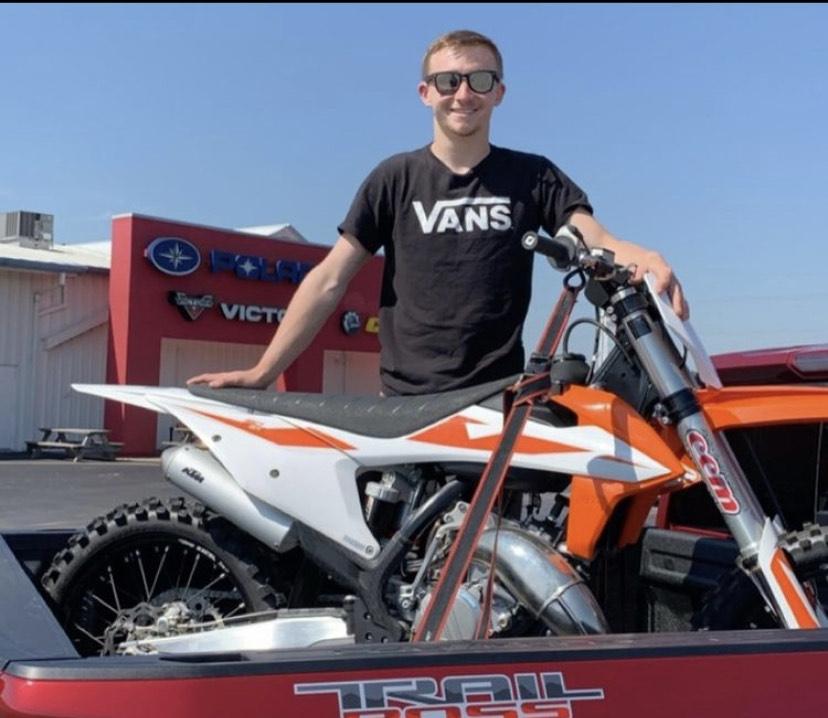 David Green poses with his orange dirtbike.