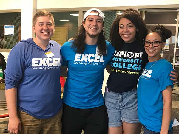 Four EXCEL students smiling