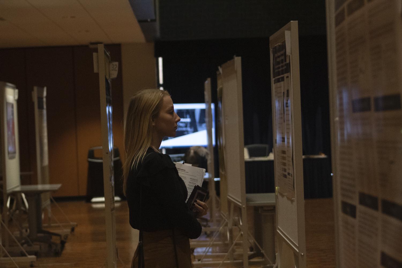 Girl looking at poster