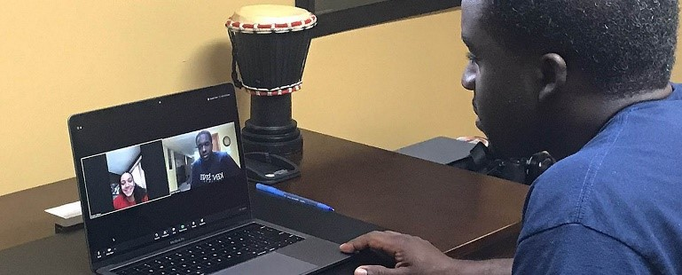 Image caption: Rising Scholars Program Coordinator Lester Sanders meets with Rising Scholars student, Kaylee Allison, remotely during the COVID-19 pandemic