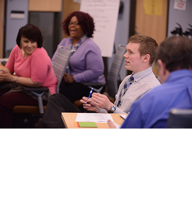 Program Participants Engage in Group Discussion