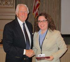 Michael Holm presents a scholarship to Jennifer Buck.