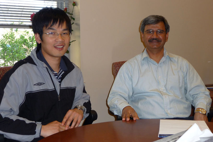 Dr. Jinhui Chen is congratulated by Dr. Satyen Kumar, Assoc VP for Research at KSU