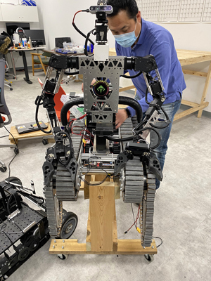Assistant Professor Jong-Hoon Kim, director of the Advanced Telerobotics Research Lab at Kent State University with Telebot-3R in the lab