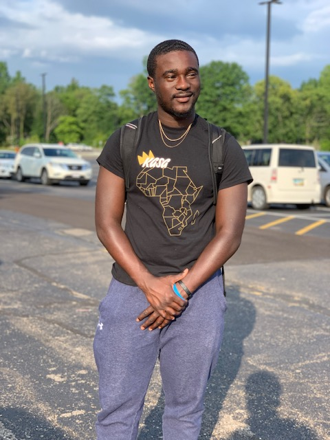 Image of Kevin Opoku in a parking lot standing