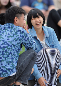 A group of international students socialize and laugh