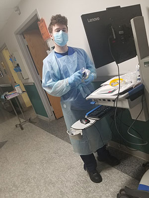 Tony Koch preparing to enter a COVID patient room at Stony Brook University Hospital in New York City.