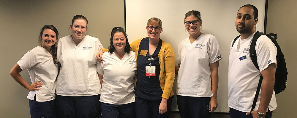 Sarah Pierce-Brown with BSN students from the Salem Campus during a clinical rotation at St. Elizabeth Hospital.