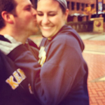 Kristen and Nicholas on Kent State main Campus embraced in a hug, smiling