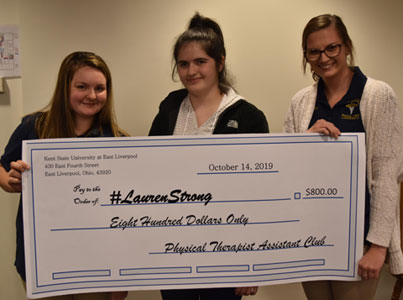 Presenting the check to Lauren Thomas (center) were PTA students Kaitlyn Meek and Alissa Opsitnik