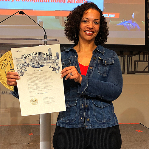 Lauren Luna holding a certificate for a day proclaimed as Lauren Luna Day in Houston, Texas
