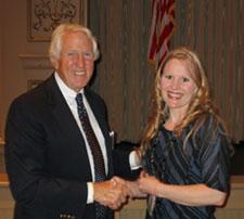 Michael Holm presents a scholarship to Lisa Kesseg