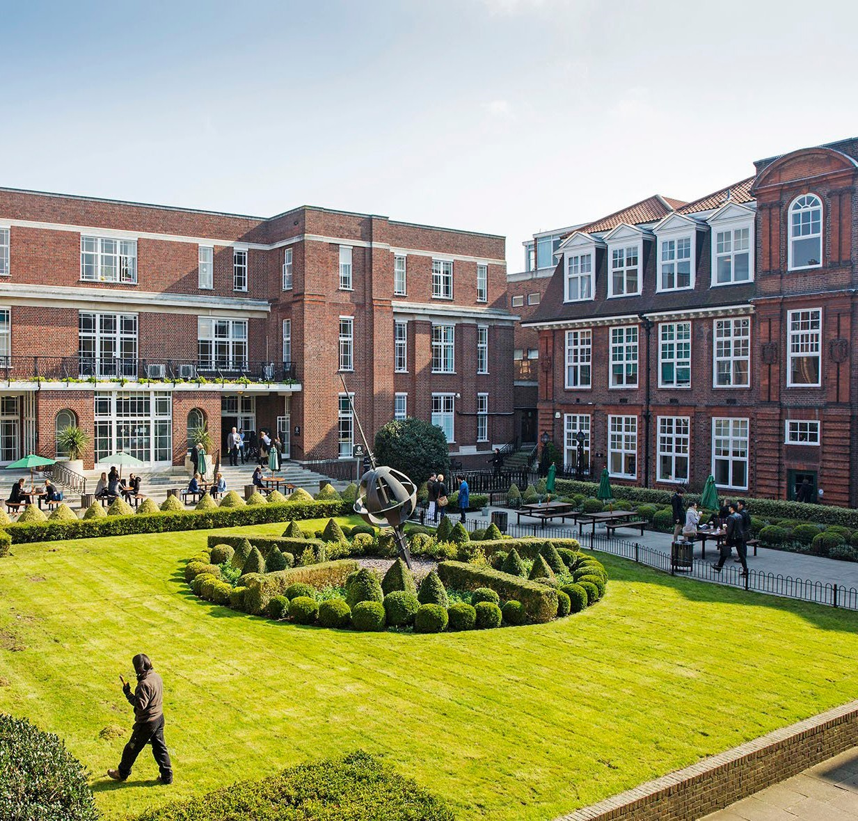 Photo of London Regent's campus overlooking a garden.