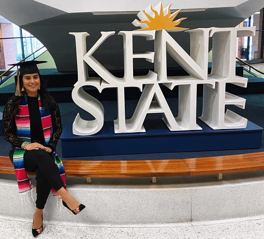 Magaly Rios in front of Kent State sign on graduation day
