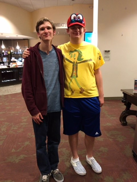 """Maxwell Rees, left, stands with his brother, Jake, after one of the showings of """"The Curious Incident of the Dog in the Nighttime."""" (Photo credit: Aimee Lambes Photography)"""