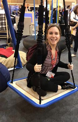 Katelyn McKinney trying out a therapeutic swing at the American Occupational Therapy Association's national conference in New Orleans