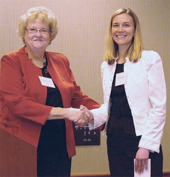 Kent State University nursing student Megan Brawley of Cleveland accepts a scholarship from Davina Gosnell, chairperson of the Ohio Nurses Foundation Board of Directors.