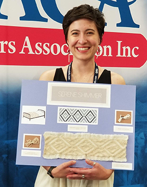 Megan Dunn accepting her award for the Alpaca Owner's Association Design Competition