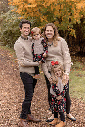 Melissa and Curt and their two daughters on a fall day