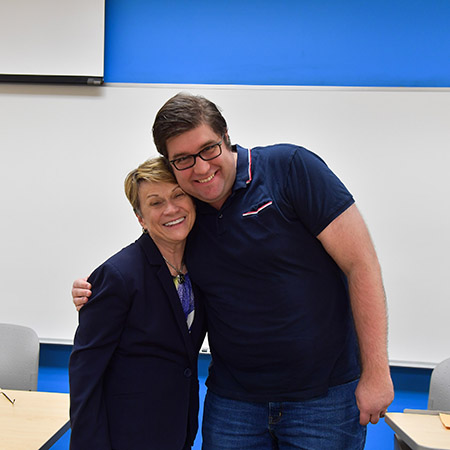 Michael Menyes, lead IT user support analyst in the Department of Psychological Sciences, receives the 2018 President's Award of Distinction from Kent State University President Beverly J. Warren.