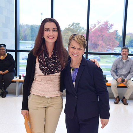 Erin Michael-McLaughlin, academic program coordinator in the Department of Chemistry and Biochemistry, receives the 2018 President's Award of Distinction from Kent State University President Beverly J. Warren.