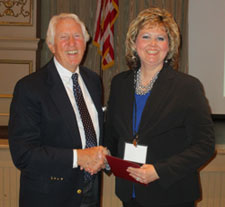 Michael Holm presents a scholarship to Michele Quinn.