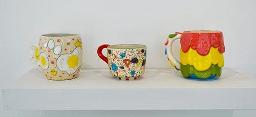 Three colorful ceramic mugs by Milo Schumann
